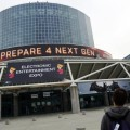 A man walks past signage outside E3 2013, the Electronic Entertainment Expo which runs from June 11 to 13, in Los Angeles, California June 9, 2013. REUTERS/Patrick T. Fallon (UNITED STATES - Tags: SCIENCE TECHNOLOGY SOCIETY)
